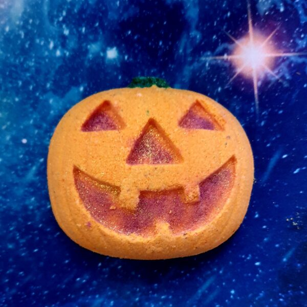 Sustainable halloween bath bomb hand made jack o lantern bath bomb